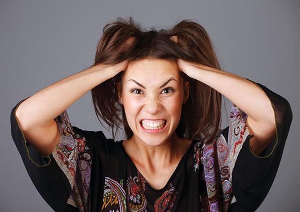 lady caught in premenstrual distress