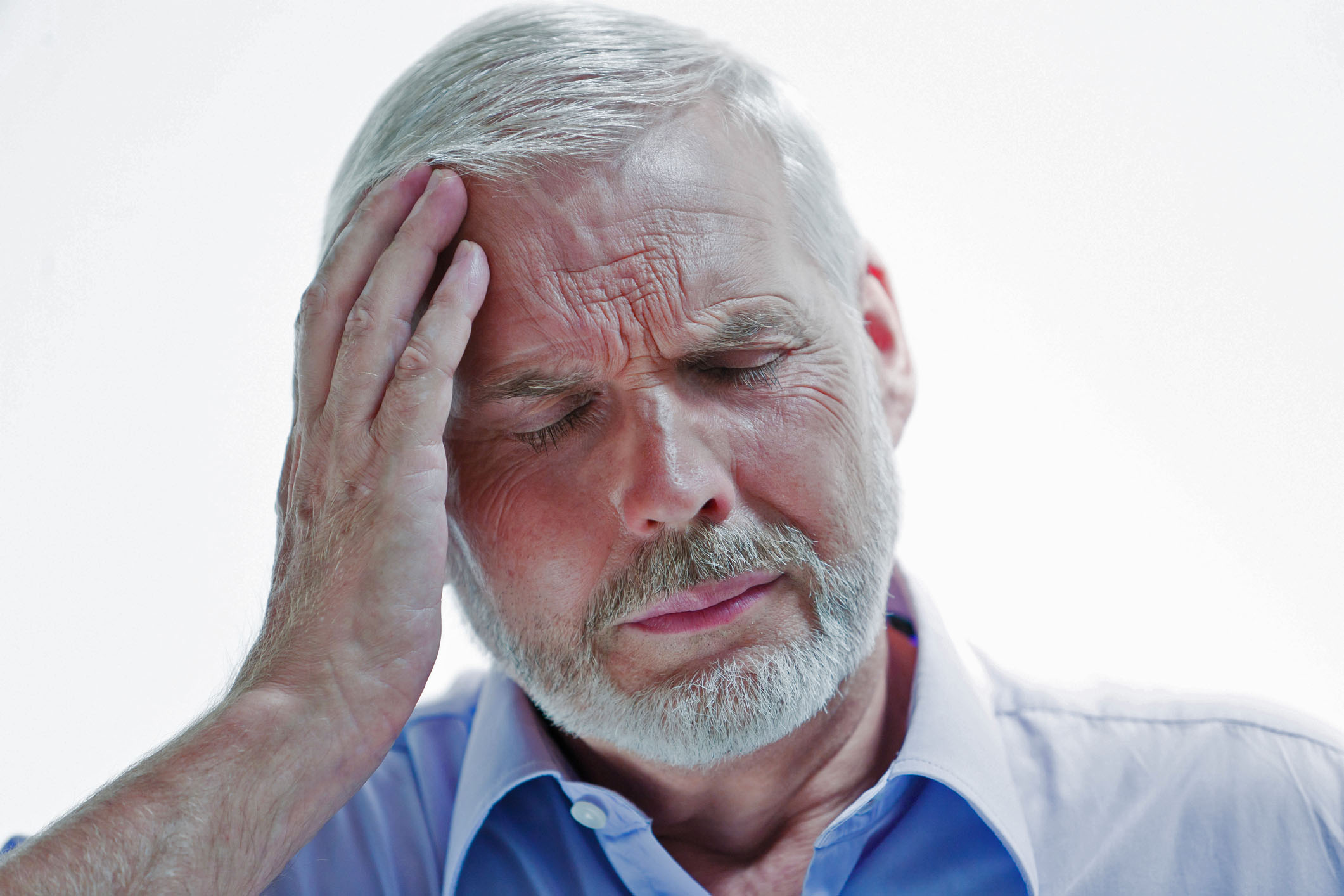 Man suffering with a Migraine headache