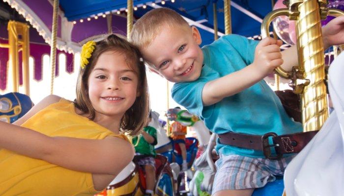 Children on Carousel at Fair