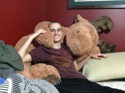 The young man and his stuffed moose.