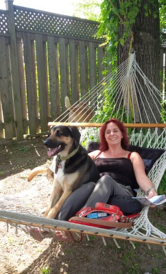 Suzanne and Bear our dog on the hammock