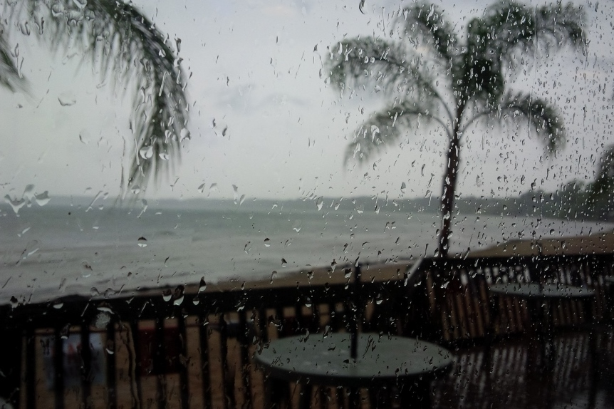 Picture of the rain hitting the restaurant window.