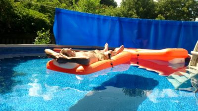 My husband floating in the pool