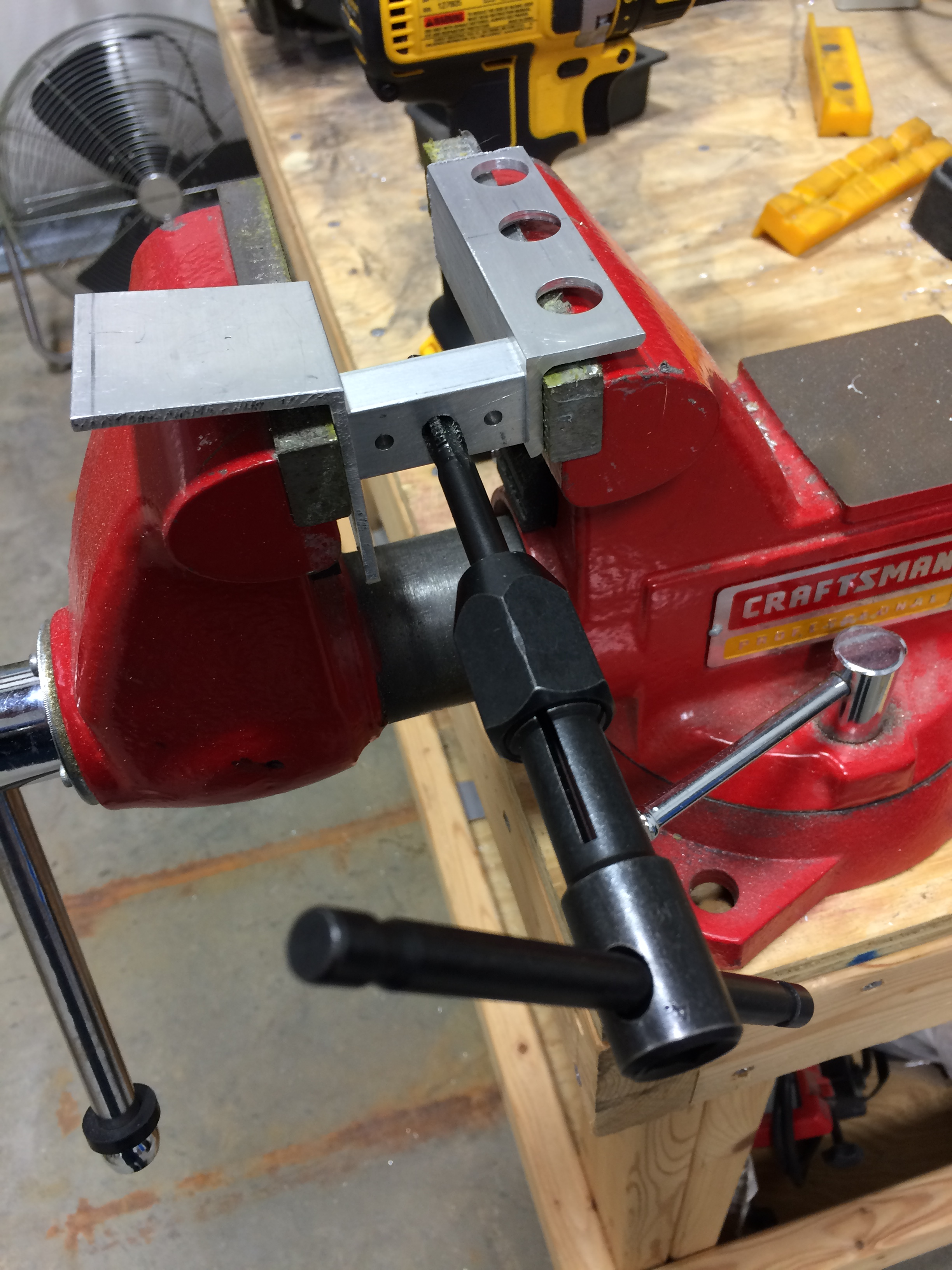 Tapping the forward strut attach points