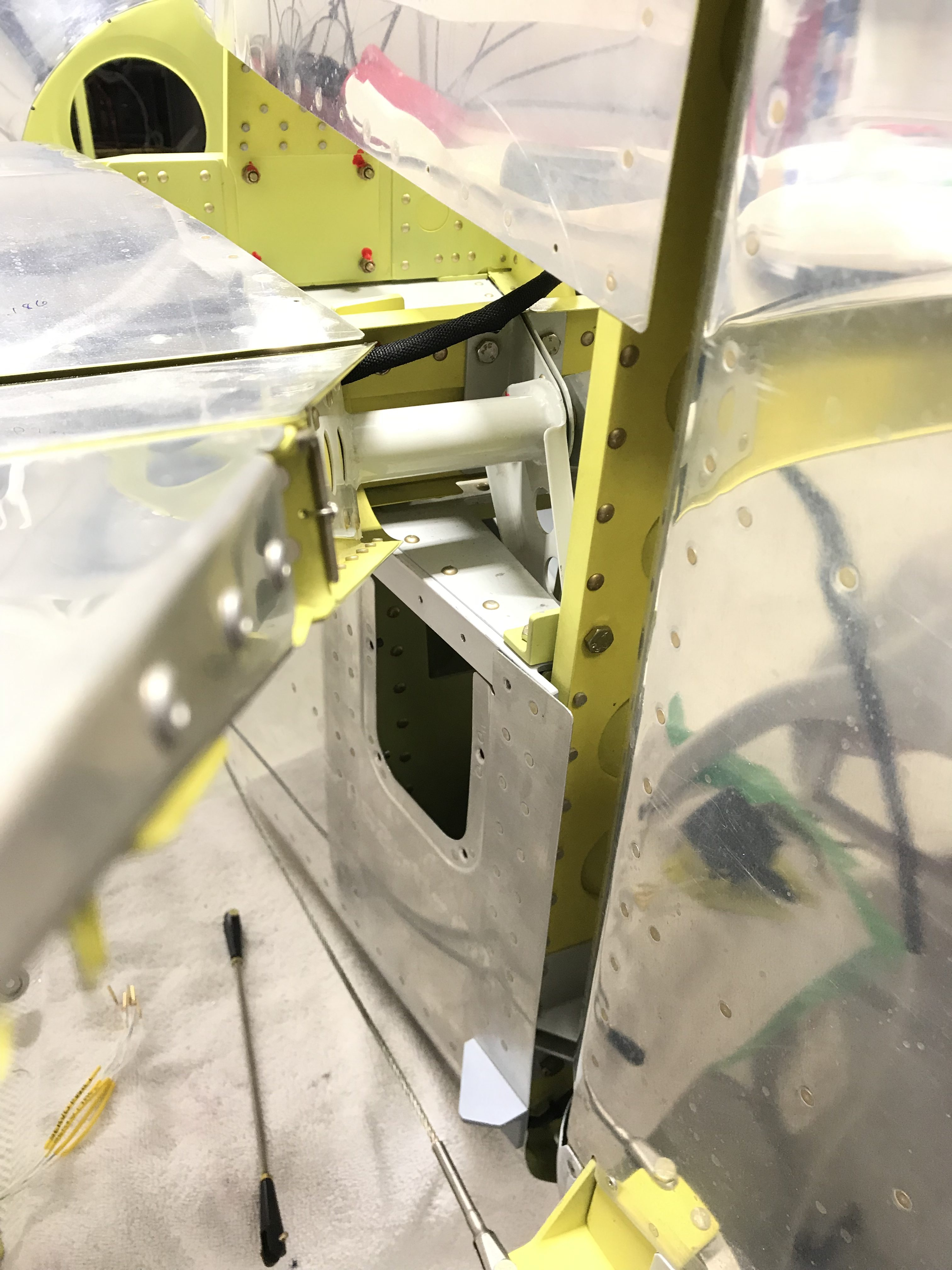Routing pitch trim wire into the elevator