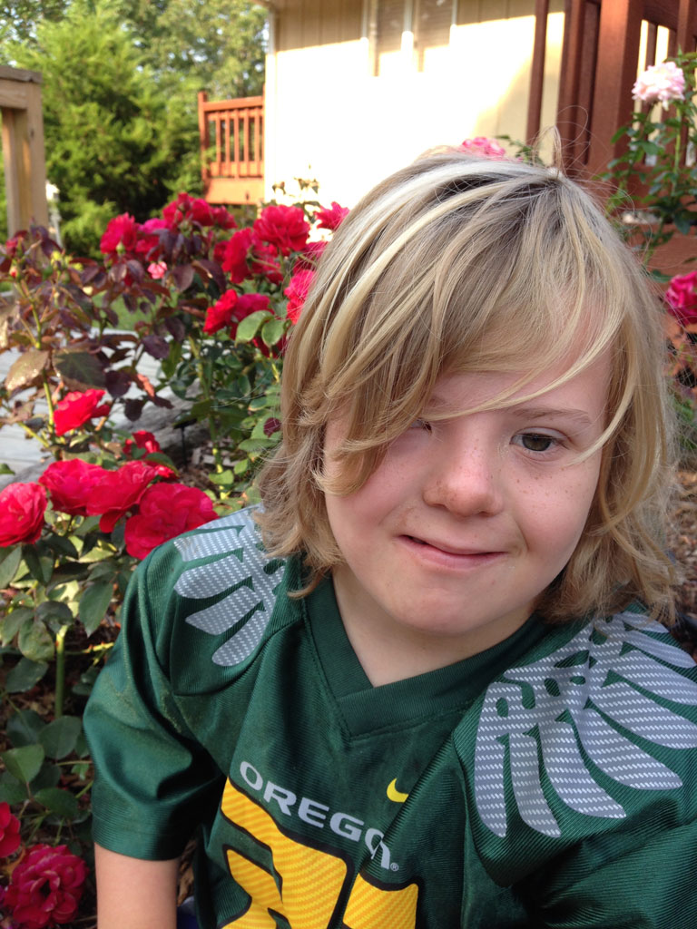 Erik my beautiful boy with Downs Syndrome and 'Europeana' in the garden