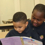 child reading to another, older child