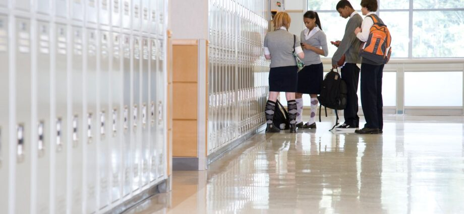 students in hallway next to lockers