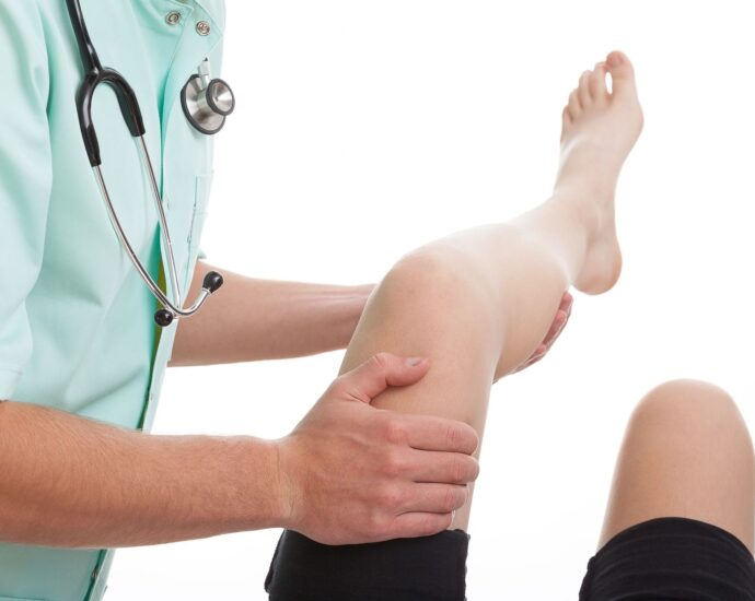 health care worker helping a leg
