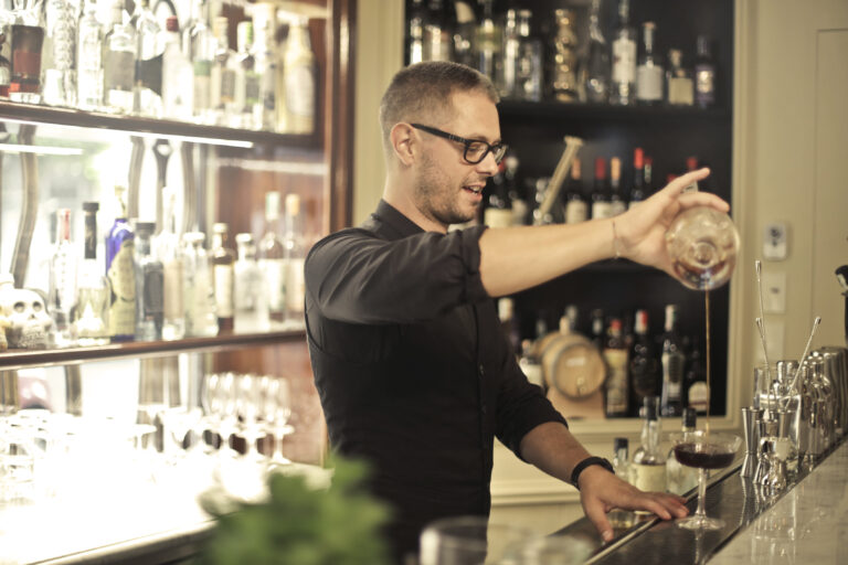 bartender-pouring-wine-into-glass-3769150
