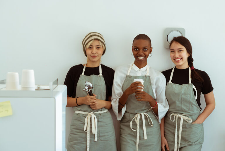 delighted-baristas-with-portafilter-and-paper-cup-4354193
