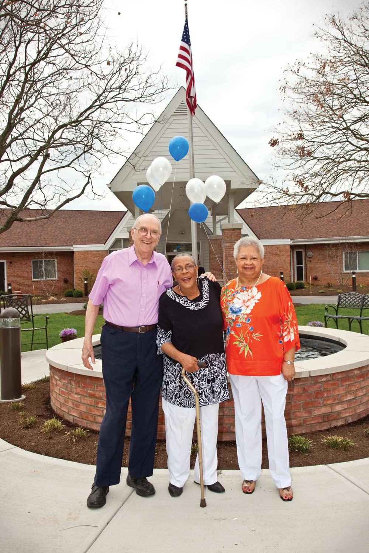 Smiling Seniors At Flag Pole