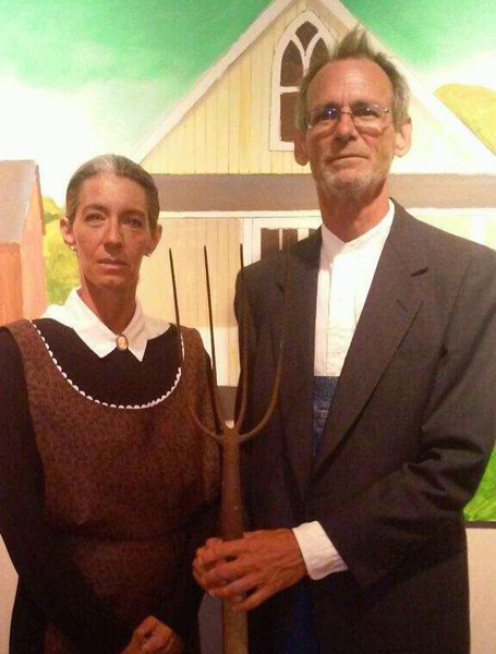 """Anna Sharp and Chris Hardcastle of Harlingen pose as live models for Schaub's recreation of """"American Gothic"""""""
