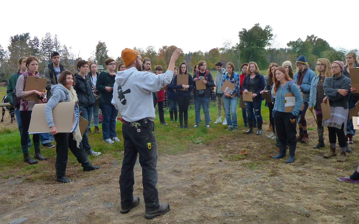 Farm manager orienting students to the farm