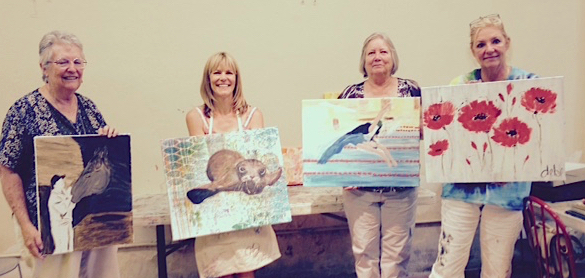 Participants displaying their work following a critique after a June, 2015 painting workshop taught at the Morean Arts Center.