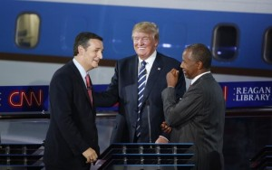 Republican U.S. presidential candidates (L-R) U.S. Senator Ted Cruz, businessman Donald Trump and Dr. Ben Carson talk during a commercial break in the midst of the second official Republican presidential candidates debate of the 2016 U.S. presidential campaign at the Ronald Reagan Presidential Library in Simi Valley, California, United States, September 16, 2015. REUTERS/Lucy Nicholson - RTS1HTQ