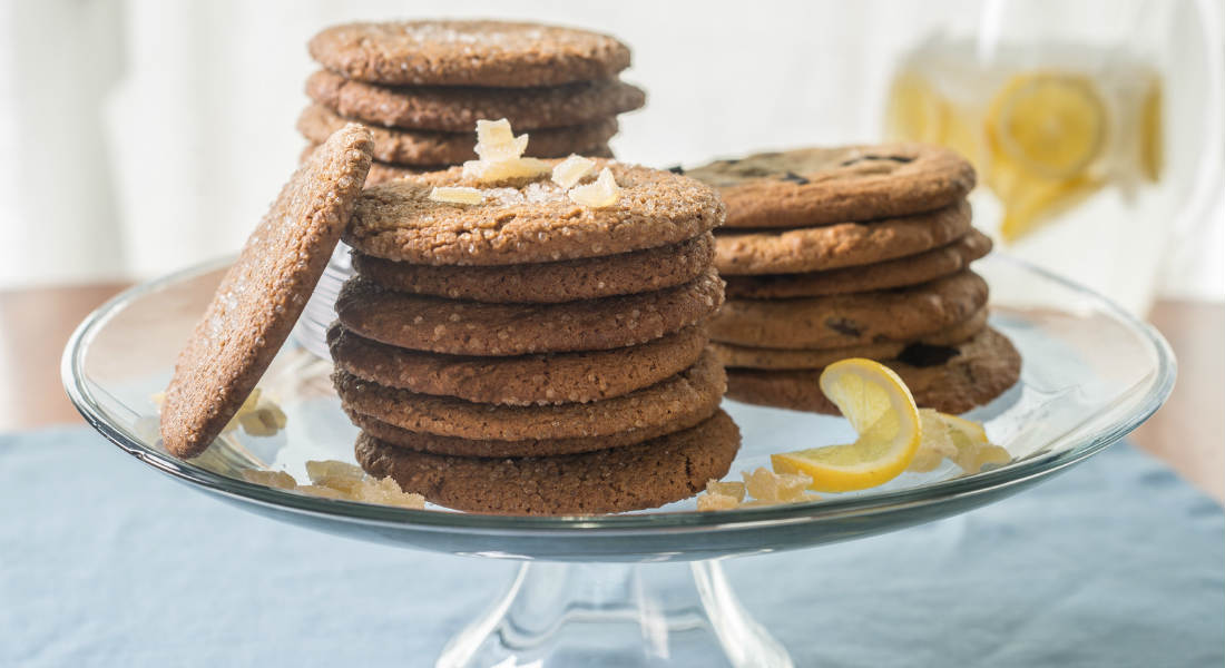 Stack of cookies on a glass plate on top of a table