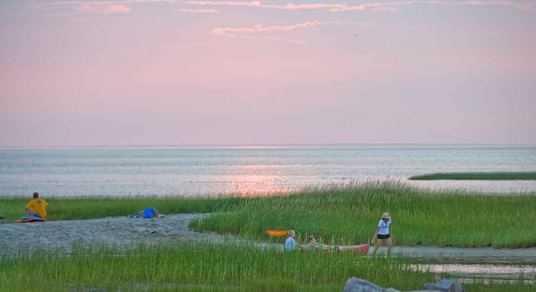 beautiful purple and dark green colors at sunset on Paines Creek in Brewster Cape Cod.