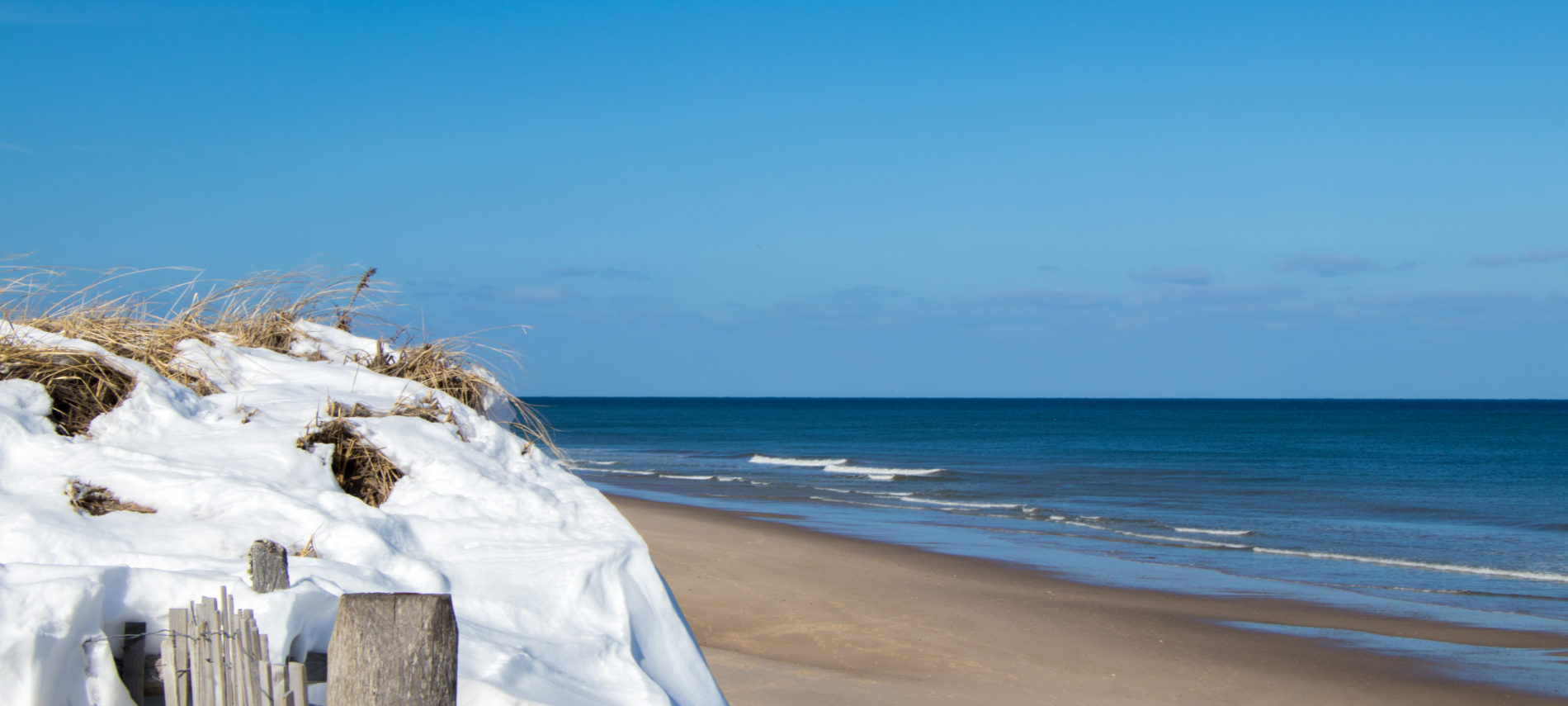 Nauset Beach with snow-covered dunes looking onto the waves