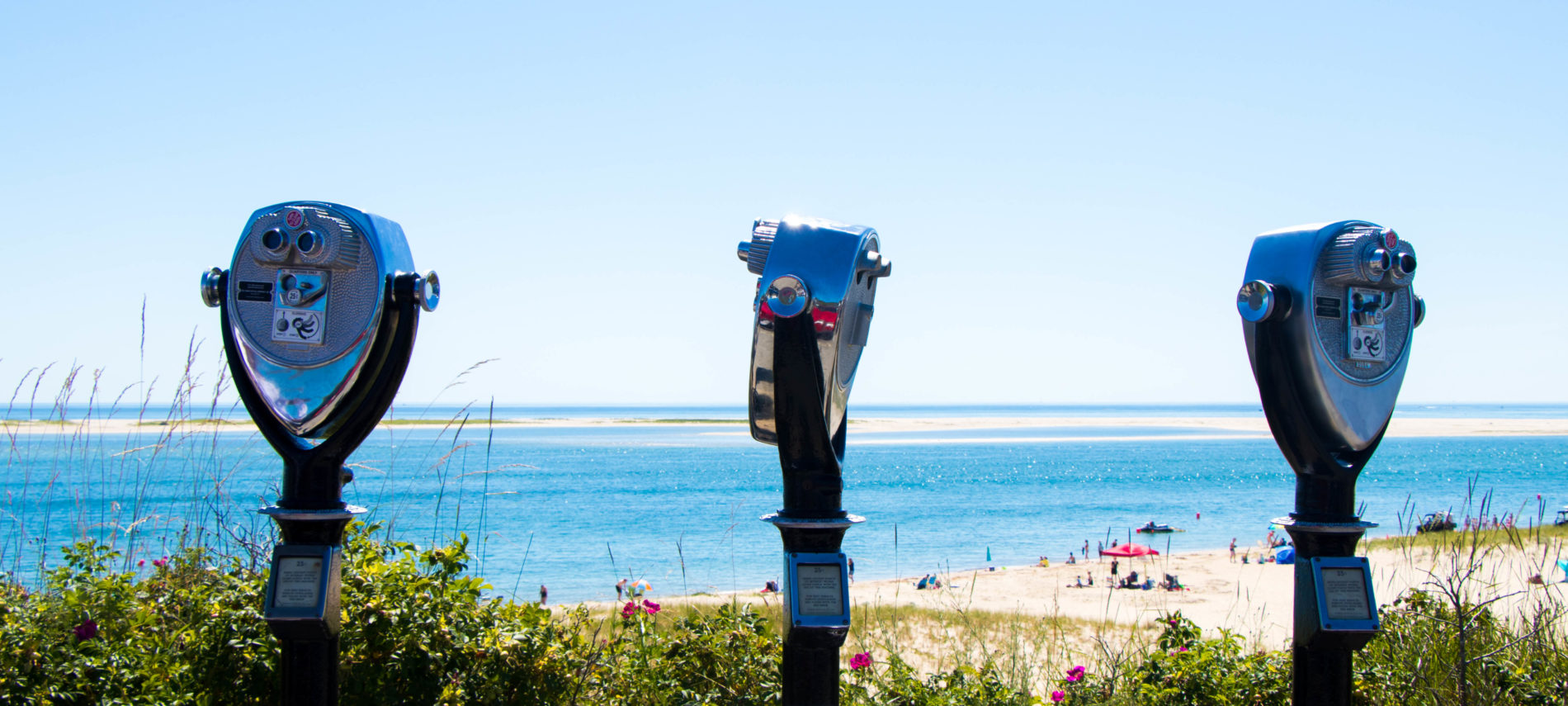 Lookout at Lighthouse Beach in Chatham with bright blue ocean water and a blue sky