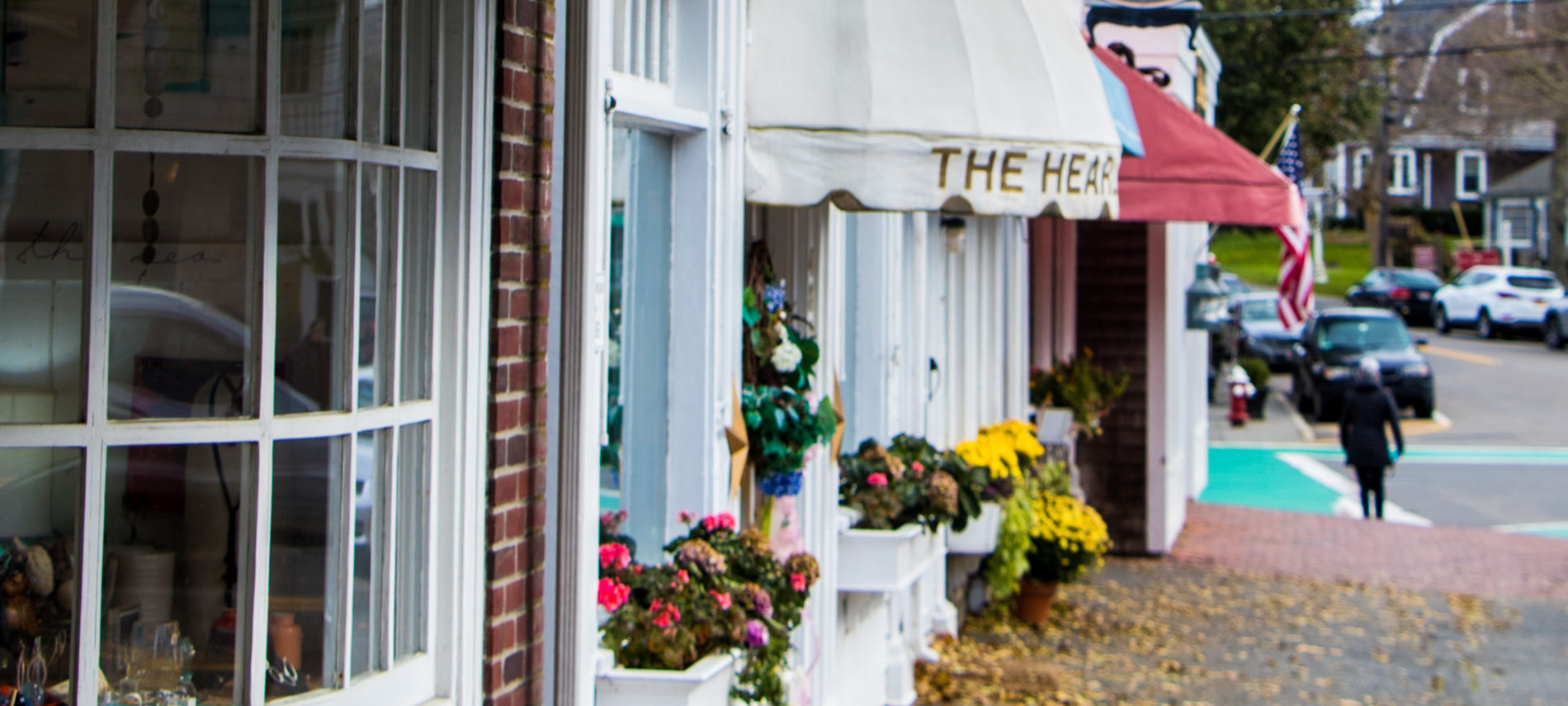 Storefronts and the sidewalk on Main Street in Chatham, MA