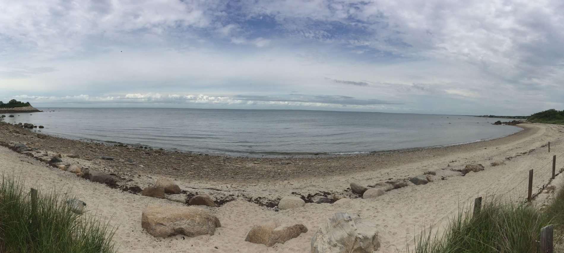 Panoramic view of The Knob beach in Falmouth on an overcast day