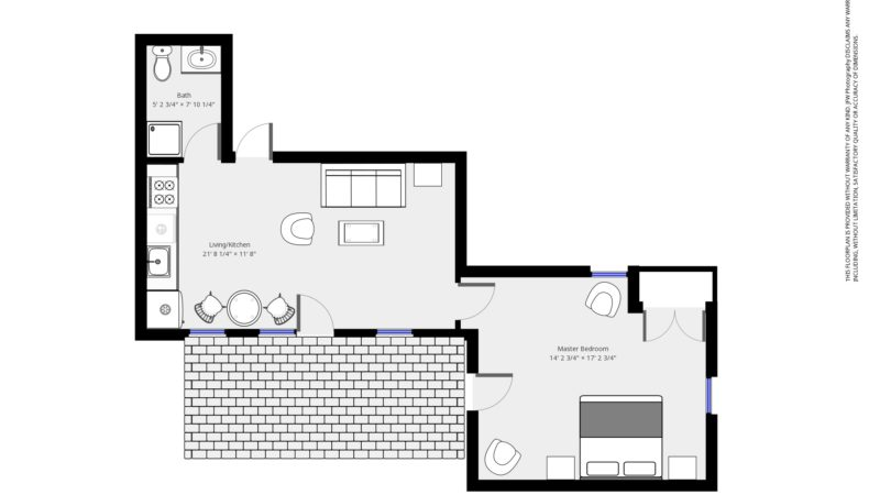 The floor plan of the Patio Suite showing the entry into the living and kitchen area with the bathroom to the right with a shower, toilet, and sink, and bedroom with walk-out patio opposite to the left of the door.