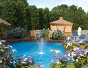Blue pool with fountain and blue hydrangeas