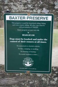 Green plaque tablet with white texts for the Baxter Reserve