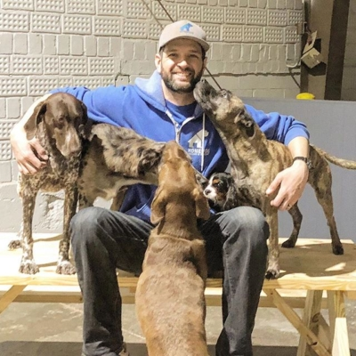 Owner of Homedog Resort in Columbus, Ohio with dogs in doggy daycare