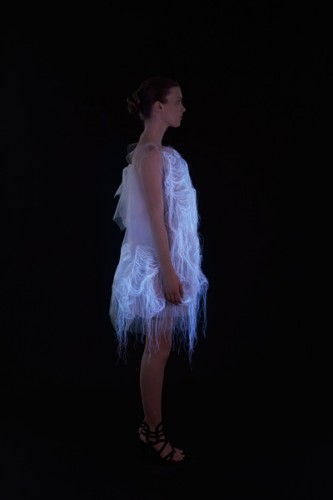 """For a project entitled """"[No]Where, [Now]Here,"""" Ying Gao created two dresses that combine super organaza, photoluminescent thread and embedded eye-tracking technology to create a dress. The luminosity of the thread is activated by the spectator's gaze. (www.yinggao.com)"""