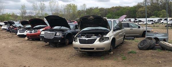 Scrap cars and scrap vans at Airway Auto Parts & Recycling in junk yard in Battle Creek, MI