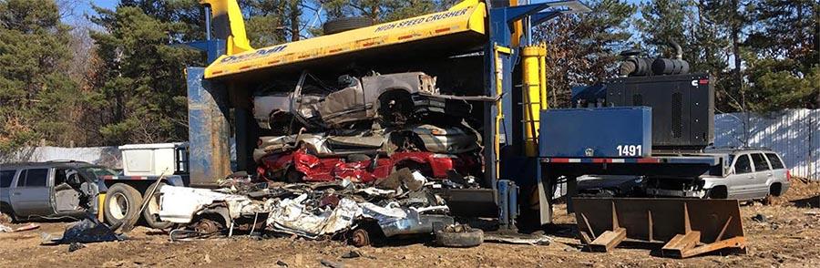 Scrap cars at Airway Auto Parts & Recycling in junk yard in Battle Creek, MI