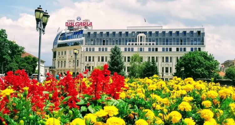 Bulgaria's Grand Hotel with flowers all around it