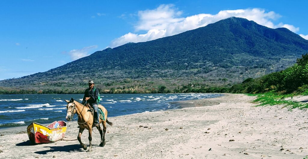 Beach view of Volcano Maderas - affordable paradise on Ometepe