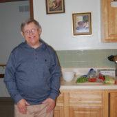 Man standing in his kitchen