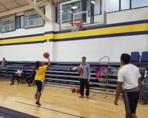 participants playing basketball