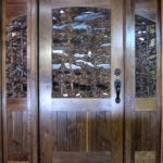 Intricately carved Walnut Entry Door with side lites