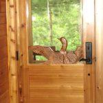 Carved loon on a cedar entry door