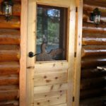 Carved loon through screen door