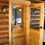 Custom built entry door with carved loon panel by John Huisman