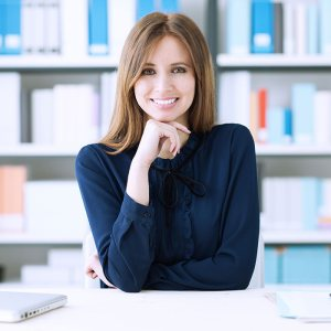 employee smiles at desk