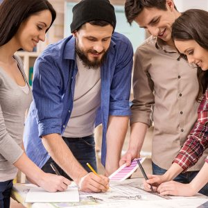productive employees working together to solve a problem