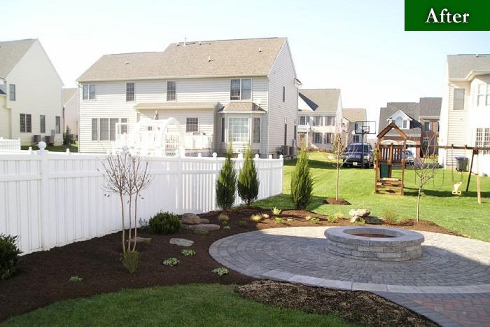 Back yard after a landscape design project of fire pit and stone heater