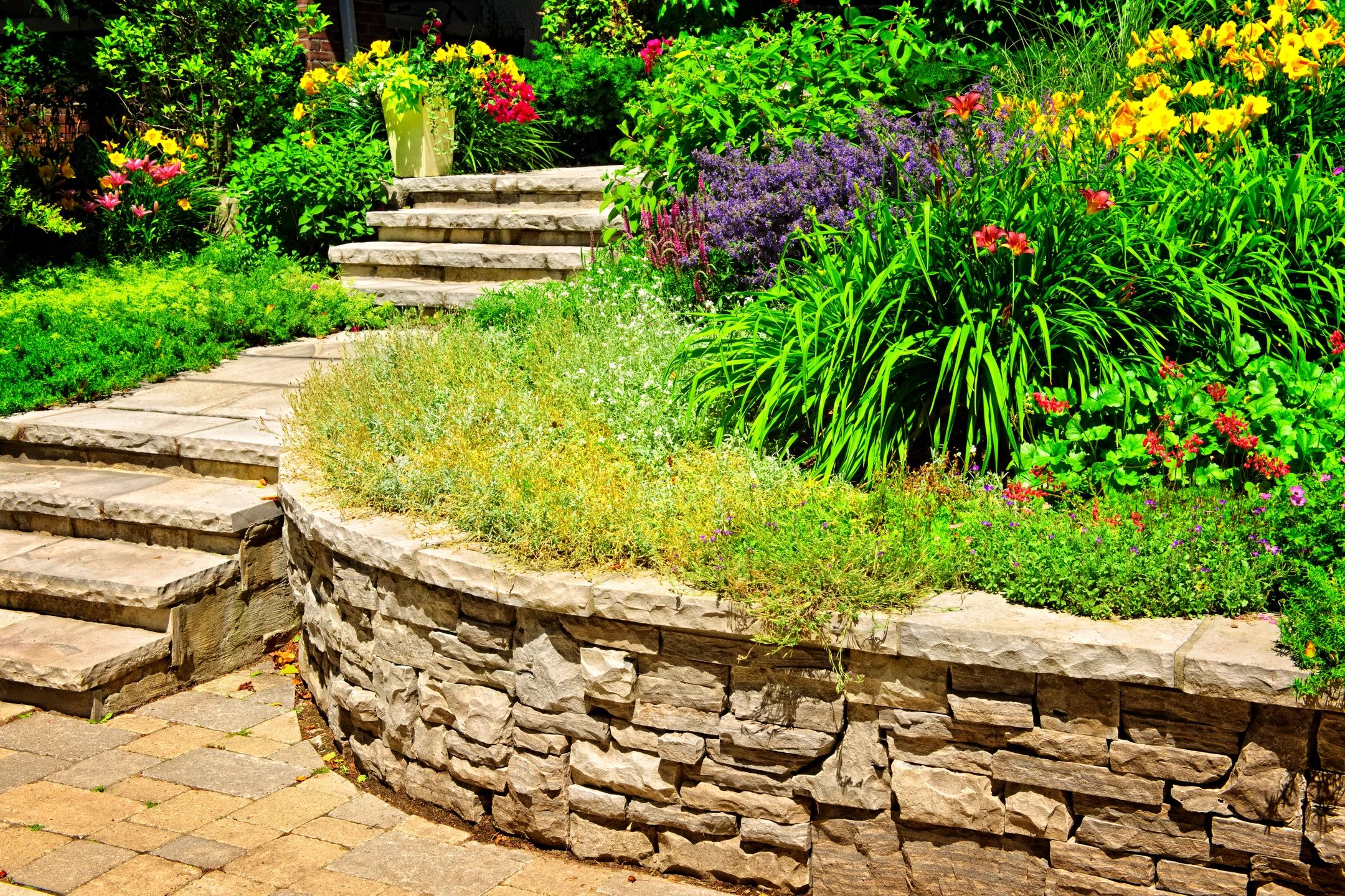 Services for your home and business garden - retaining wall and stone staircase.