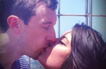 Malia and MJ UT Tower Kiss Picture