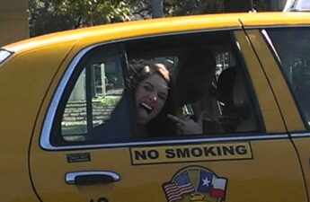 Malia Sticking Her Tongue Out and Flipping MJ Off While Riding In A Taxi Cab Photo Taken In Austin Texas