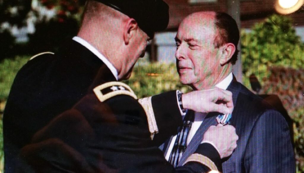 Photo of Private First Class Richard H. Adler receiving the Silver Star