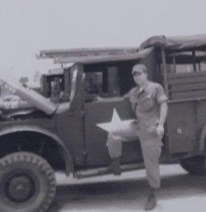 Sergeant Paul Schuler with a truck