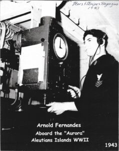 Arnold Fernandes operating sonar for a picture in Stars and Stripes Magazine 1943